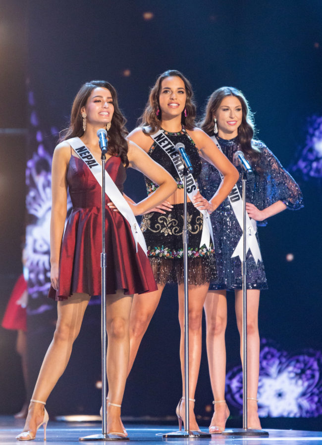 Manita Devkota, Miss Nepal 2018; Rahima Dirkse, Miss Netherlands 2018; and Estelle Curd, Miss New Zealand 2018; on stage in fashion by Sherri Hill during the opening of the MISS UNIVERSE® Preliminary Competition at IMPACT Arena in Bangkok, Thailand on Thursday, December 13th. The Miss Universe contestants have been touring, filming, rehearsing and preparing to compete for the Miss Universe crown in Bangkok, Thailand. Tune in to the FOX telecast at 7:00 PM ET live/PT tape-delayed on Sunday, December 16, 2018 from the IMPACT Arena in Bangkok, Thailand to see who will become the next Miss Universe. HO/The Miss Universe Organization